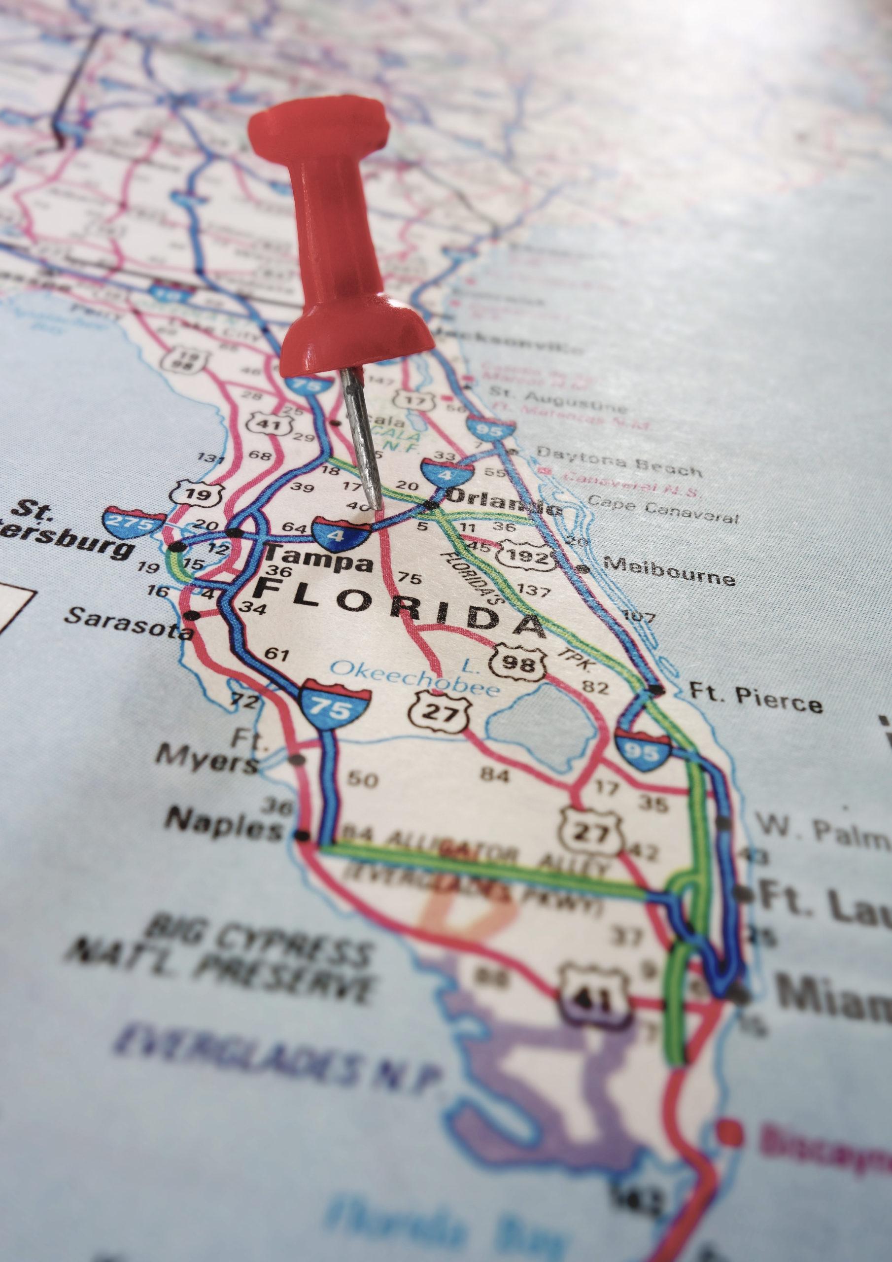 Closeup of a Florida map with a red push pin